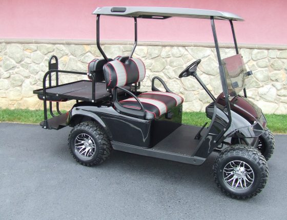 ezgo golf cart with rear platform add on and light grey roof