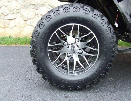 freshly polished golf cart chrome wheel and tire